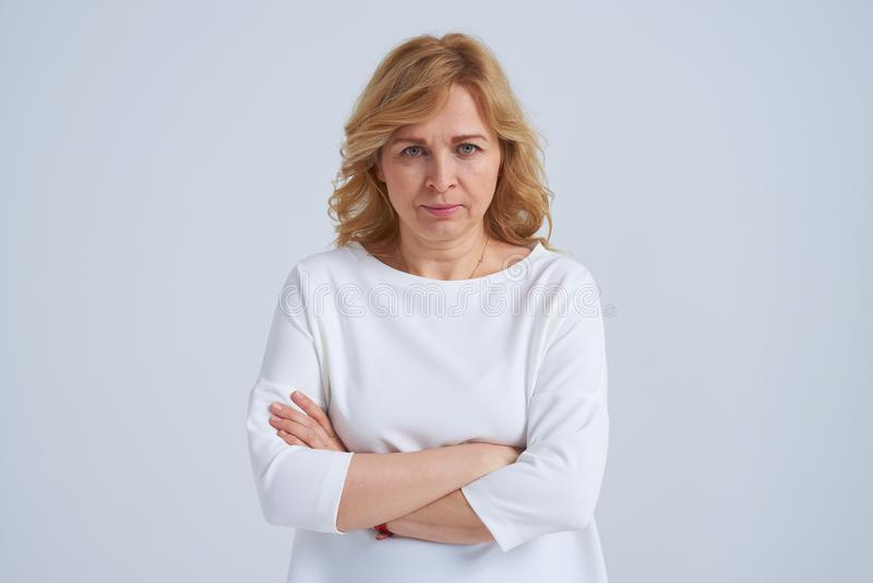Serious mature woman posing stock image