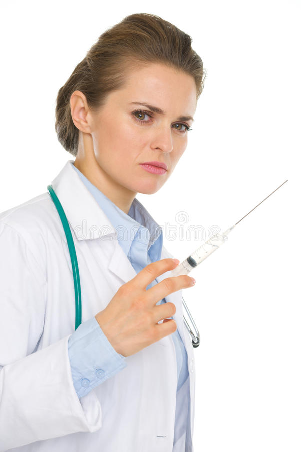 Serious medical doctor woman with syringe stock photography