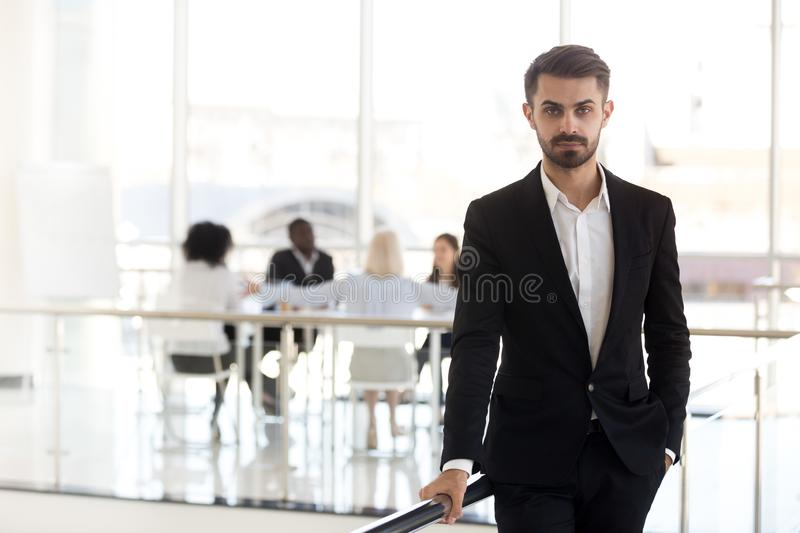 Serious millennial corporate leader or executive ceo looking at stock photos