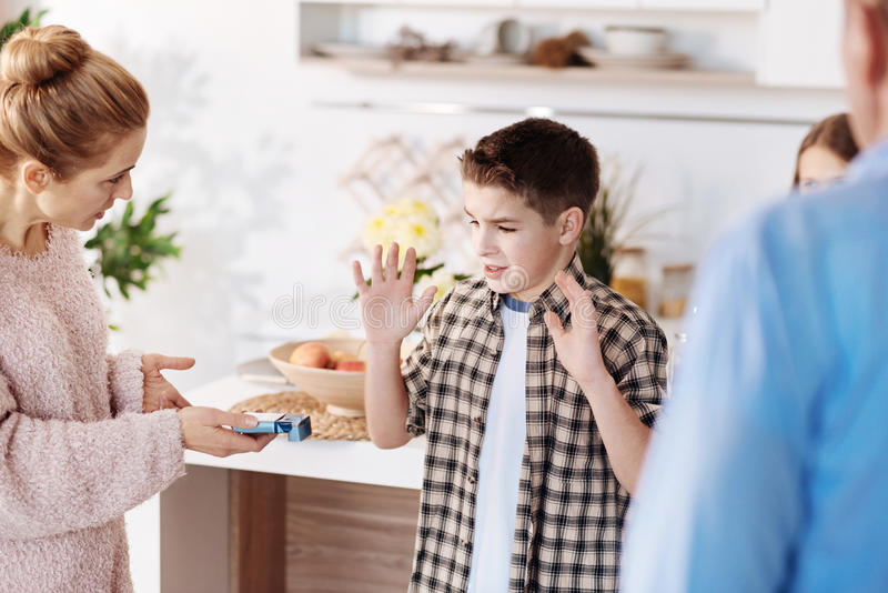 Serious mother scolding her son stock photography