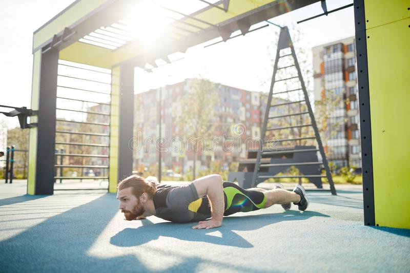 Concentrated on push-ups royalty free stock image