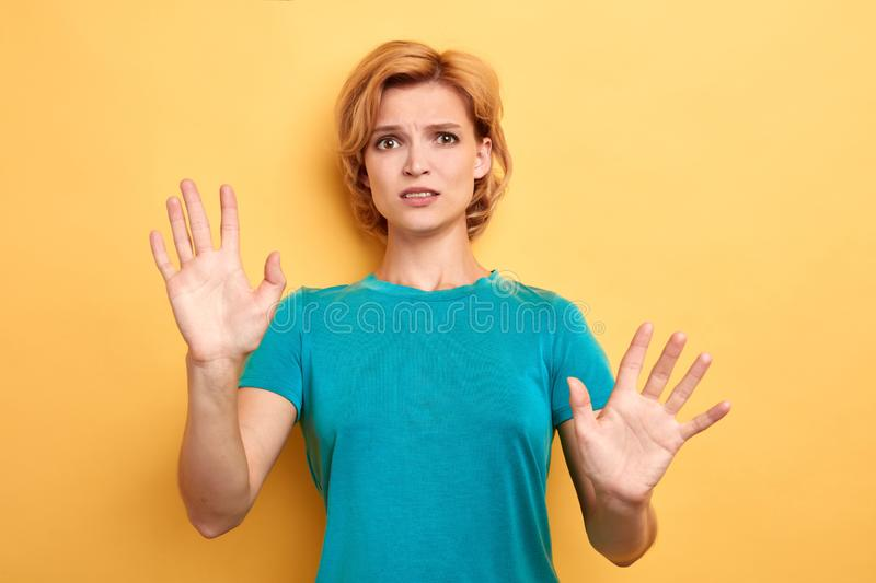 Serious nervous blonde woman shows palms in camera stock photography