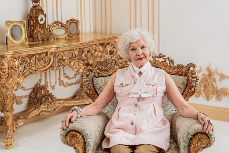 Download Serious Old Lady Sitting On Luxury Armchair Stock Photo - Image of active consideration  sc 1 st  Dreamstime.com & Serious Old Lady Sitting On Luxury Armchair Stock Photo - Image of ...