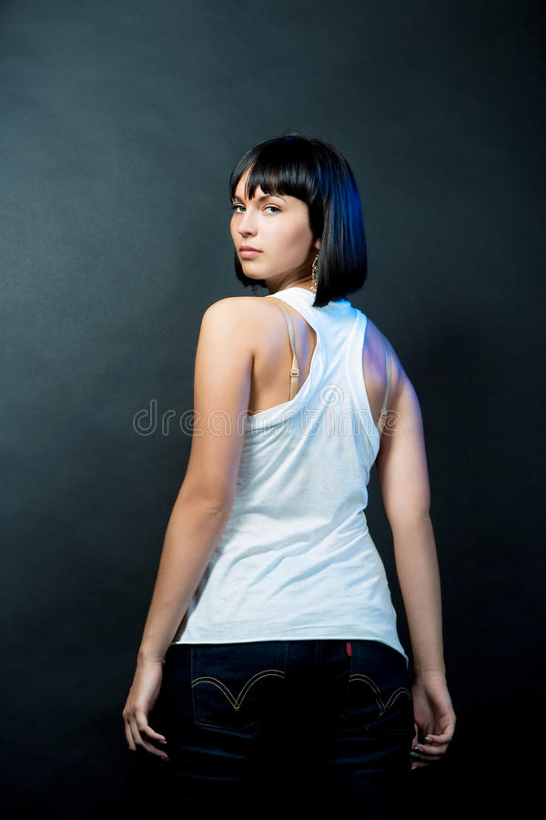 Serious passion look back of young caucasian girl stock photography