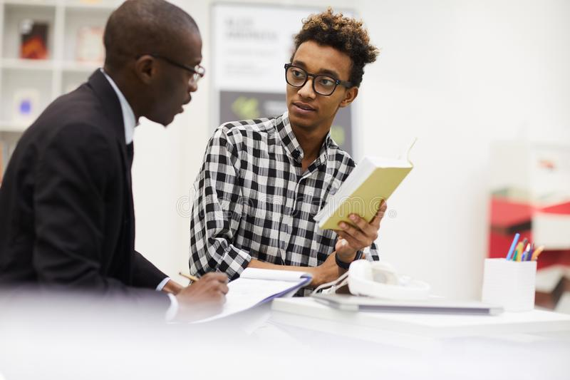 Black guys discussing ideas for project stock photography