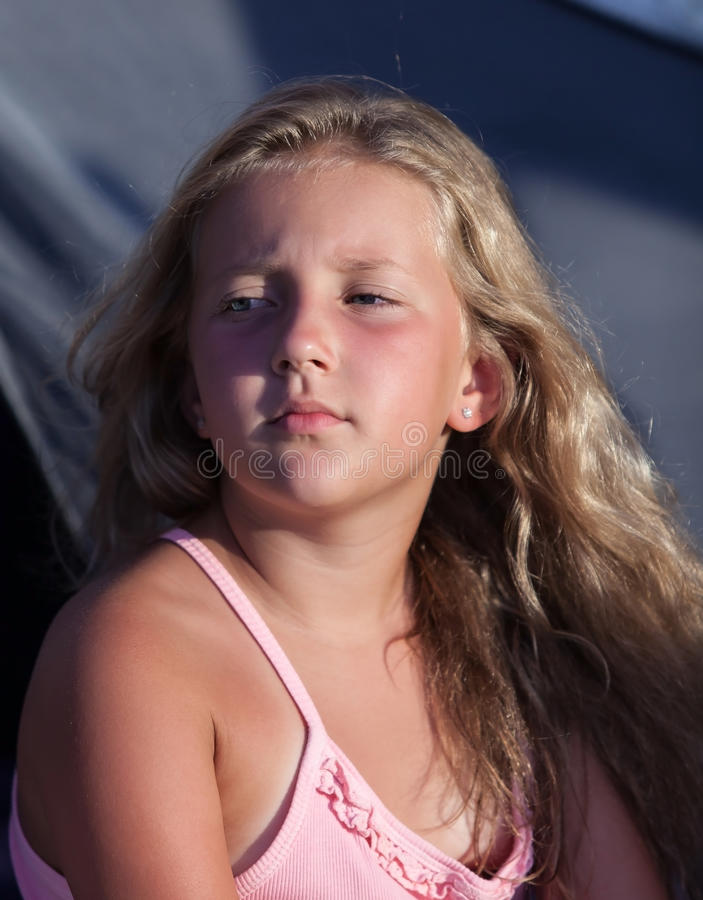 Serious pretty blond girl on vacation royalty free stock photography