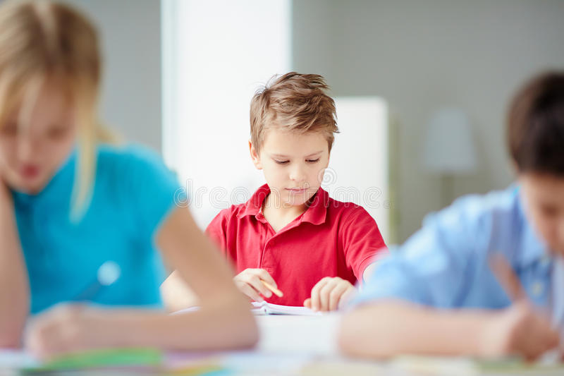 Serious pupil royalty free stock photography