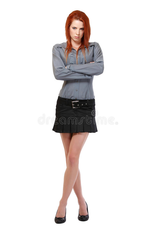Serious redhead woman posing on white background royalty free stock photos