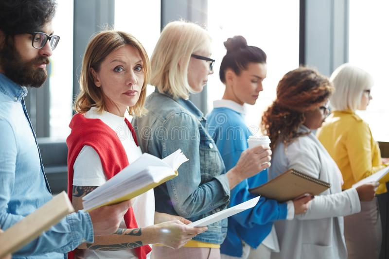 Serious woman in long line stock photography