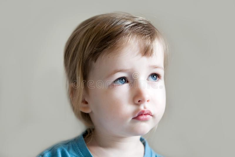 Serious and sad three years old girl portrait royalty free stock photos