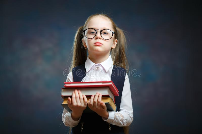 Serious Schoolgirl Wear Glasses Hold Pile of Book. Adorable Smart Elementary School Student in Big Spectacle. Clever Little Caucasian Girl. Kid Ready to Study stock images