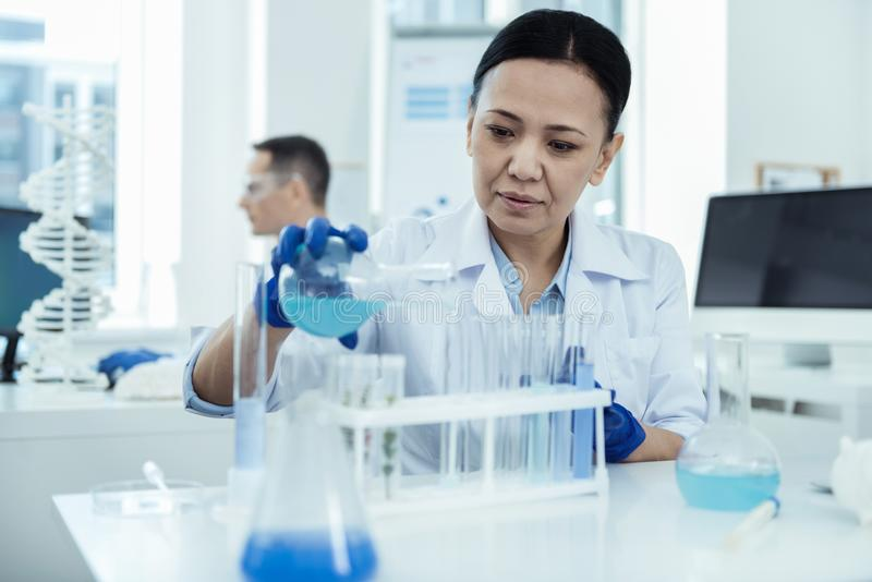 Serious scientist making an important experiment stock photo