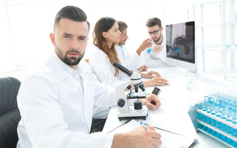 Serious scientists working in the laboratory stock images