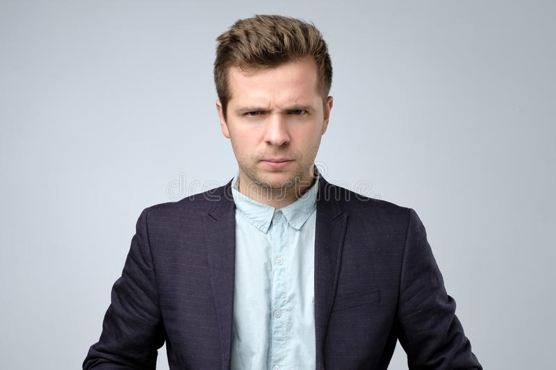 Serious self confident young businessman in suit stock photography