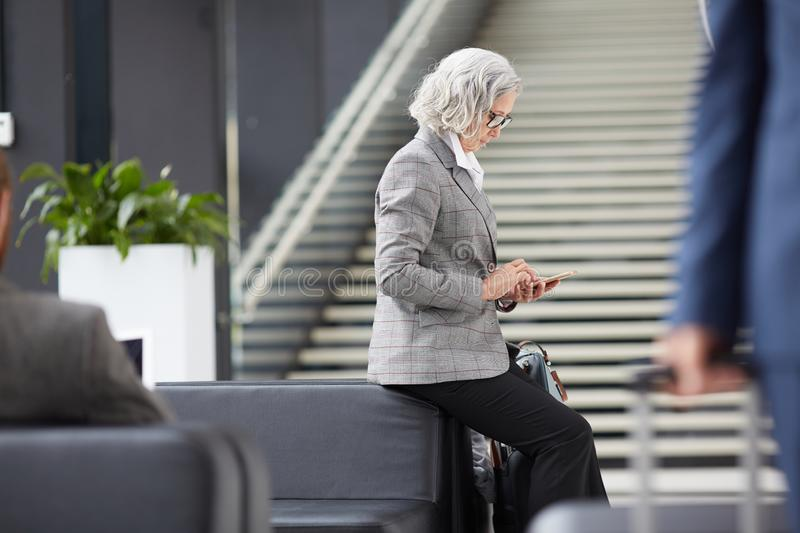 Asian businesswoman waiting for check-in time royalty free stock photography