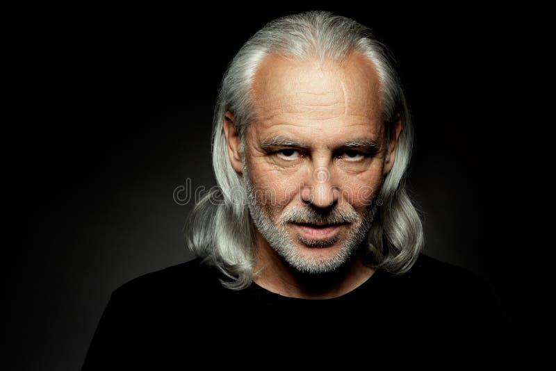 Serious senior bearded man royalty free stock photos