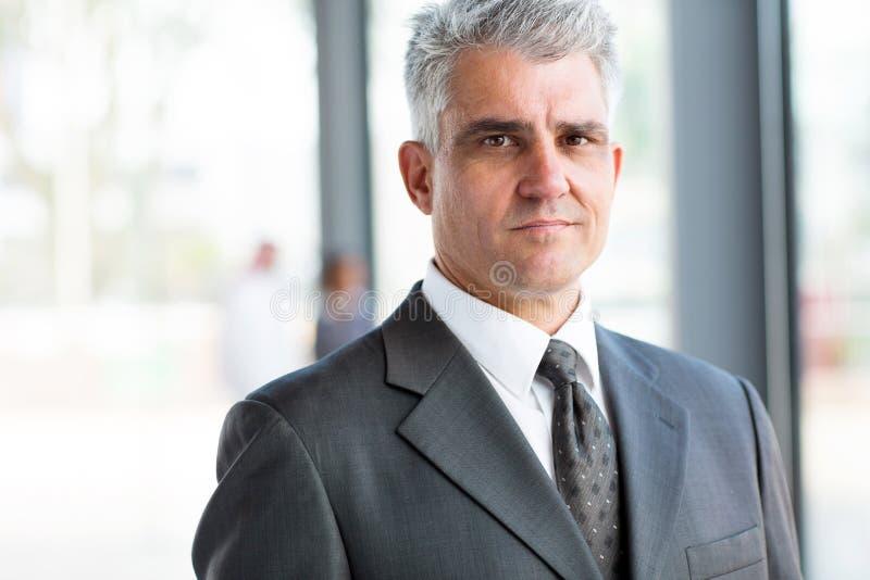 Serious senior businessman stock photography