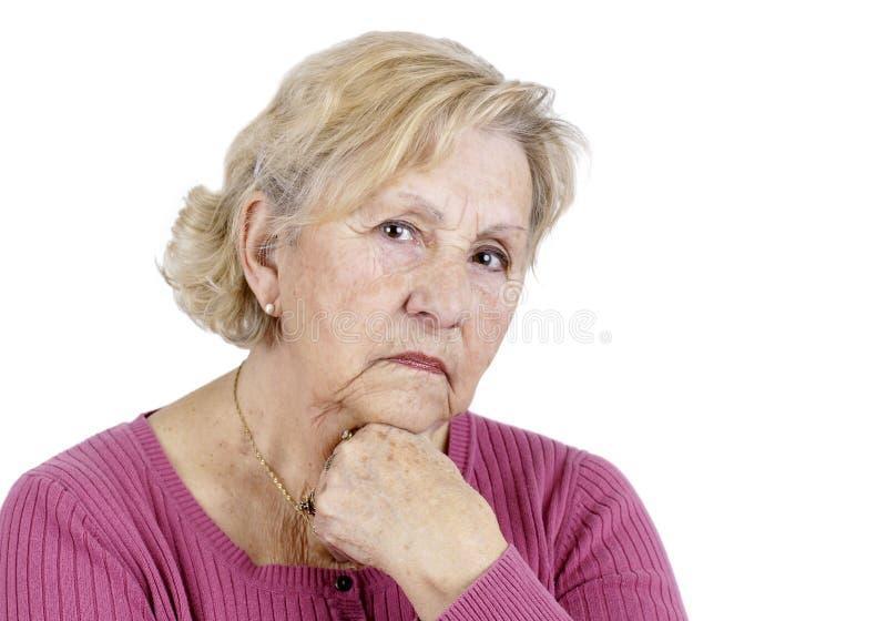 Serious senior woman stock photo