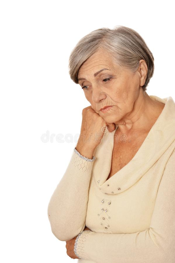 Close up portrait of serious senior woman posing, isolated on white royalty free stock images