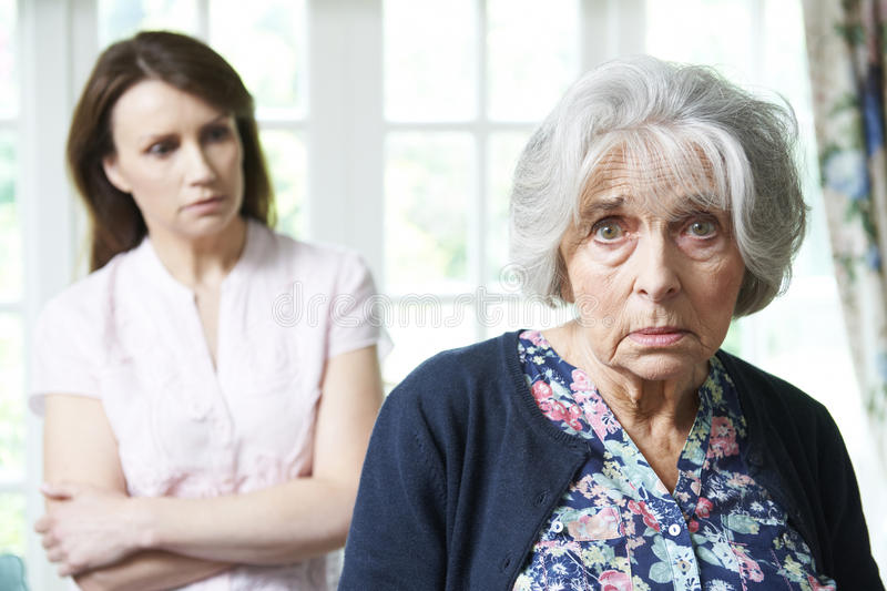 Serious Senior Woman With Worried Adult Daughter At Home. Portrait Of Serious Senior Woman With Worried Adult Daughter At Home stock photography