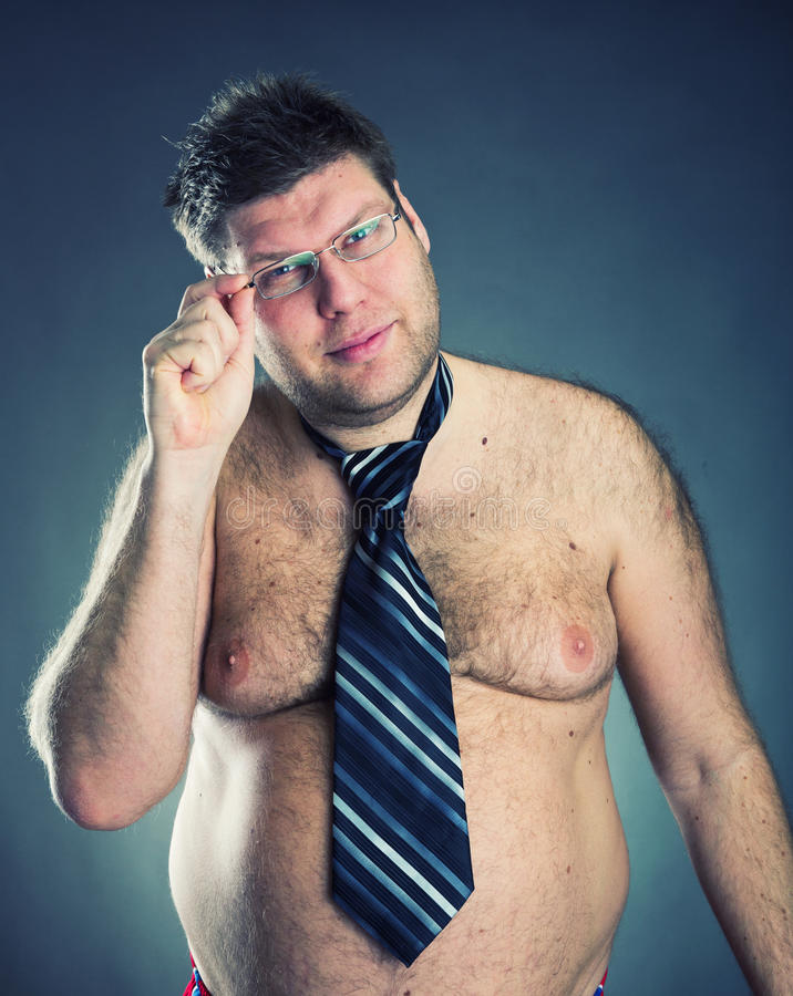 Serious shirtless man. Weard tie and glasses royalty free stock photos