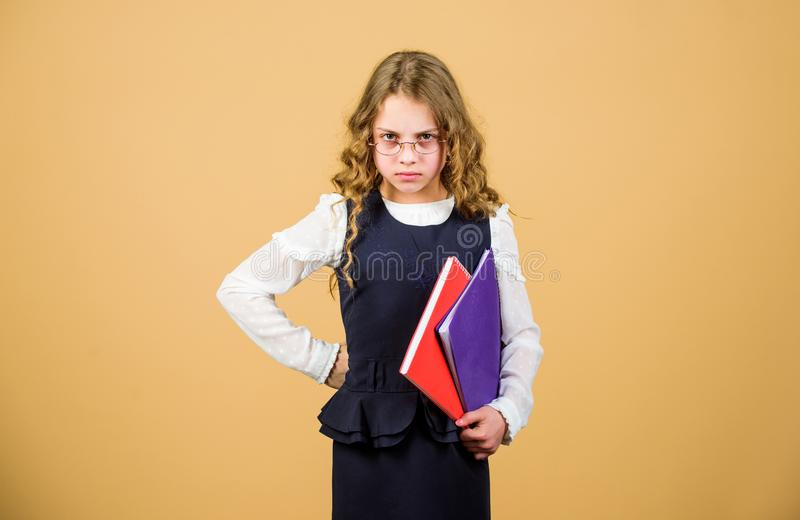 Serious small girl wants to be teacher. notebook for diary notes. study lesson. knowledge and education. Back to school. Hometwork. small girl with paper stock images