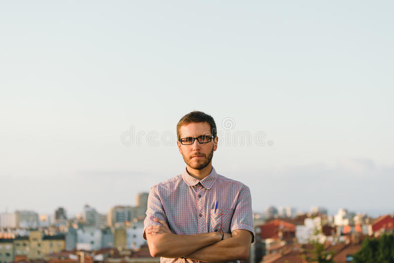 Serious smart lookin man crossing arms royalty free stock image
