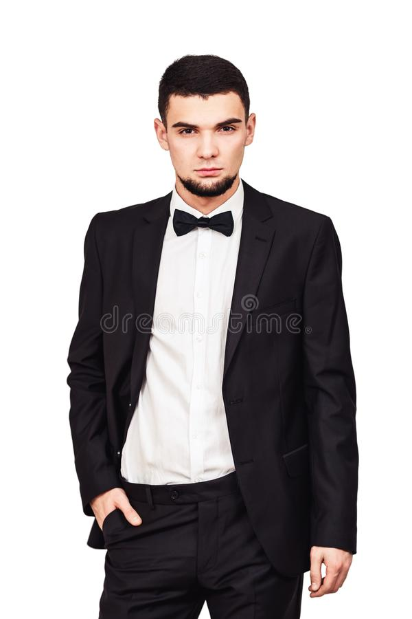 Serious strict businessman or boss in a black suit in full growth royalty free stock photos