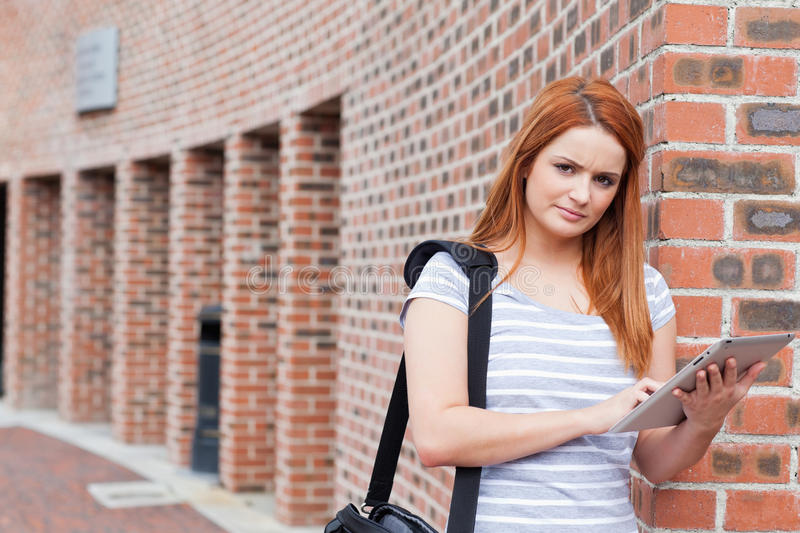 Download Serious Student Holding A Tablet Computer Stock Photo - Image: 21248336
