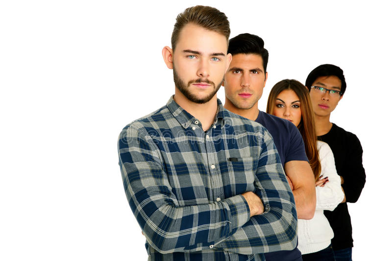Serious students with arms folded stock photo