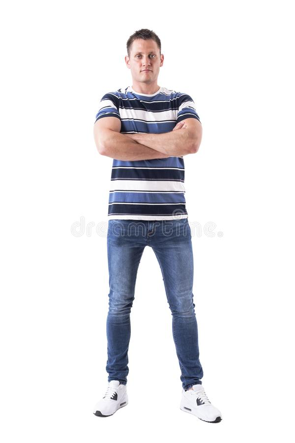 Serious successful man with blank facial expression looking at camera with crossed arms. stock images