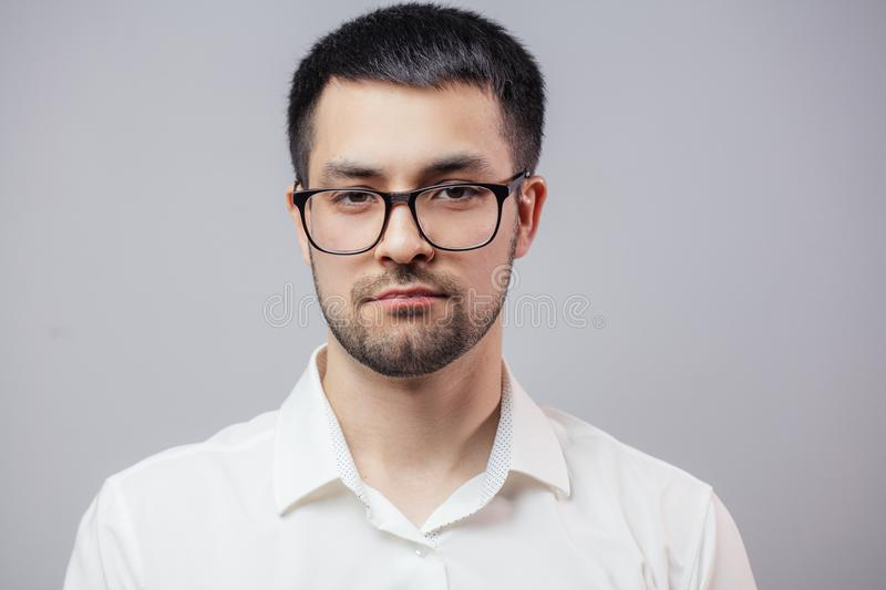 A serious successful young businessman wearing glasses stock photo