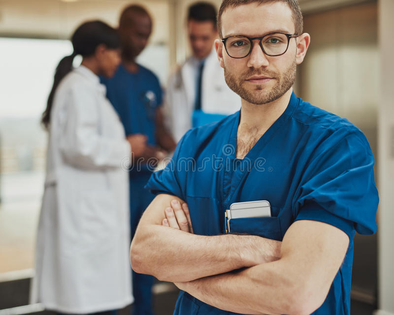 Serious surgeon in front of team royalty free stock photos