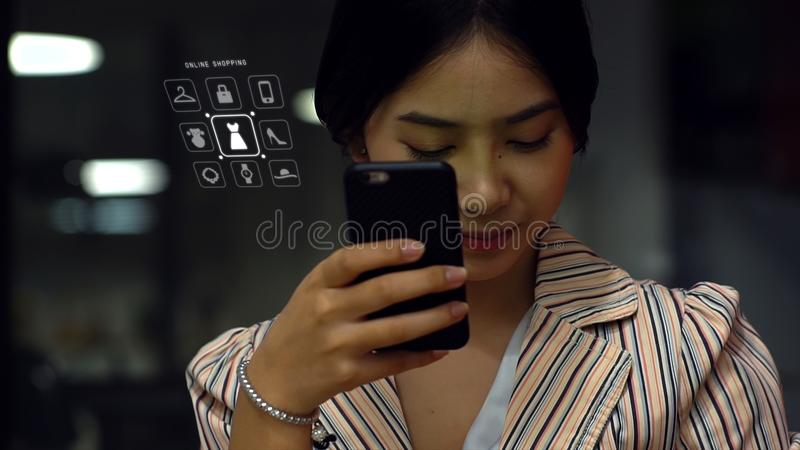 Serious teen girl with cellphone stock photography