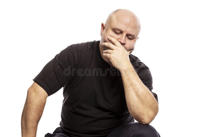 Serious thoughtful bald man royalty free stock photos