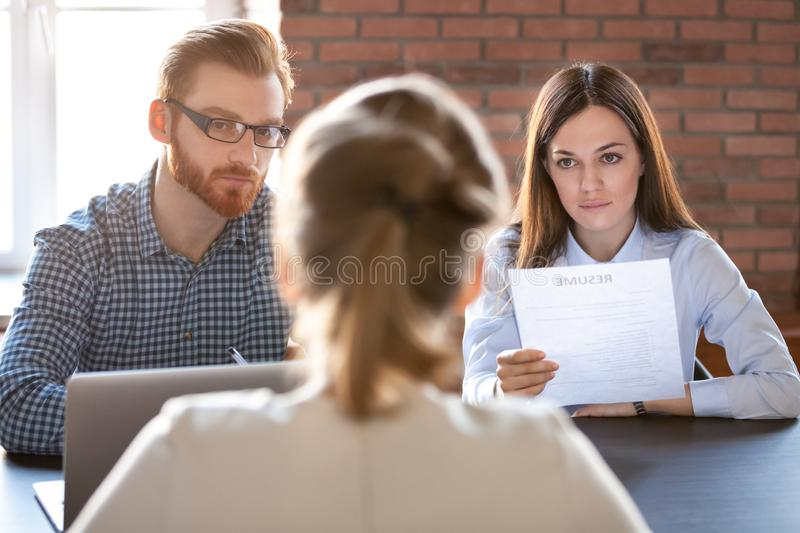 Serious thoughtful hr attentively listening to applicant at job stock images