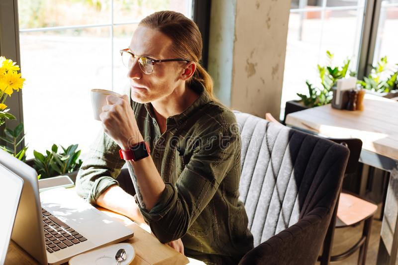 Serious thoughtful man having a break for coffee royalty free stock photography