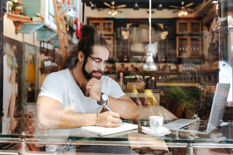 Serious thoughtful man sitting in front of the laptop royalty free stock images