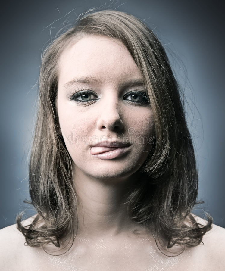 Download Serious Thoughtful Woman Showing Tongue Stock Photo - Image: 7157198