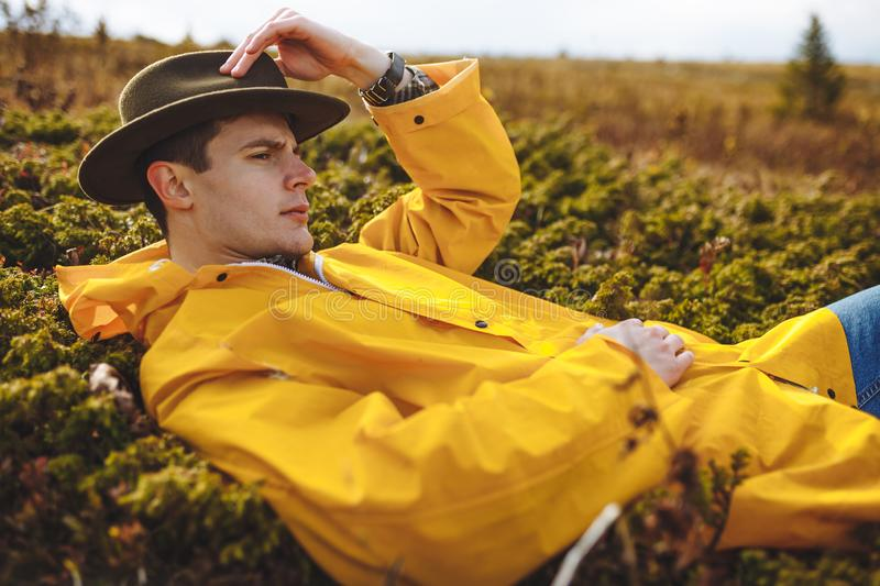 Serious guy lying on the grass royalty free stock photos