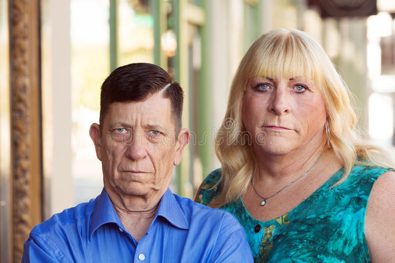 Serious transgender couple standing together royalty free stock photography