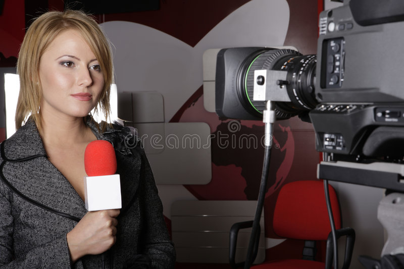 Serious TV reporter in live transmission stock image