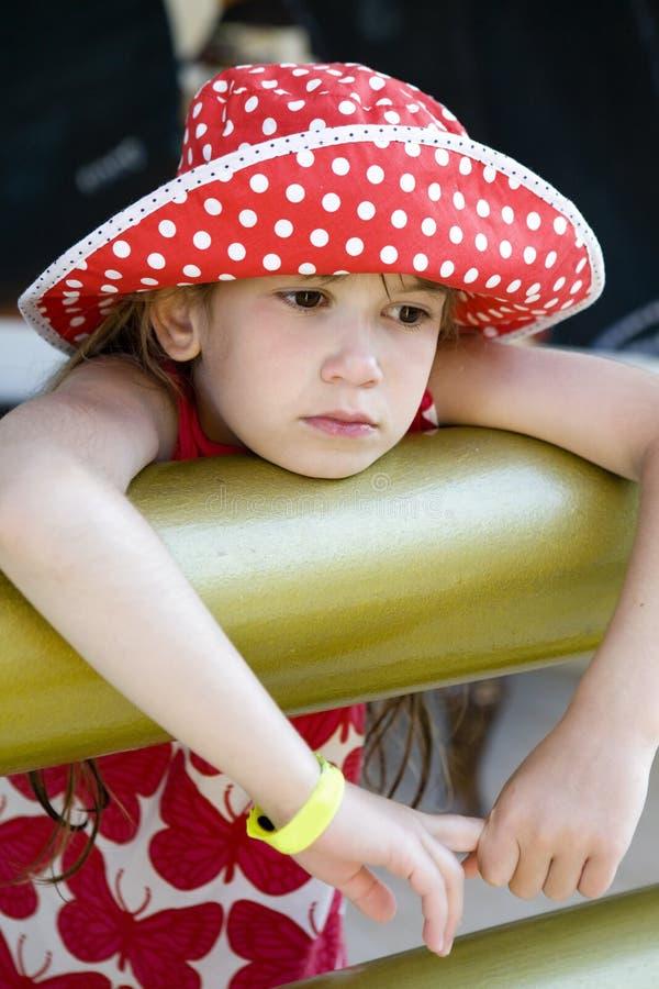Serious upset girl wearing Panama
