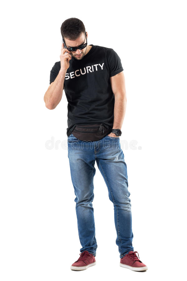Serious upset plainclothes policeman talk on the phone looking down stock photos