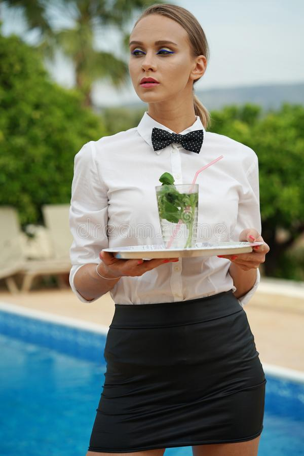 Free Serious Waitress By The Work Stock Photo - 118673970