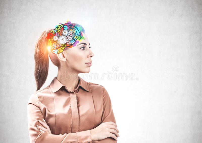 Serious woman with crossed arms brainstorming royalty free stock photo
