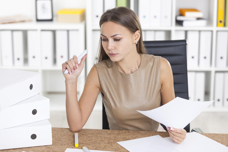 Serious woman doing paperwork royalty free stock image