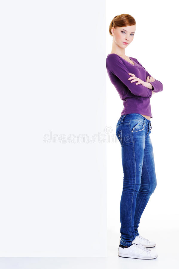 Serious woman near the blank banner royalty free stock images