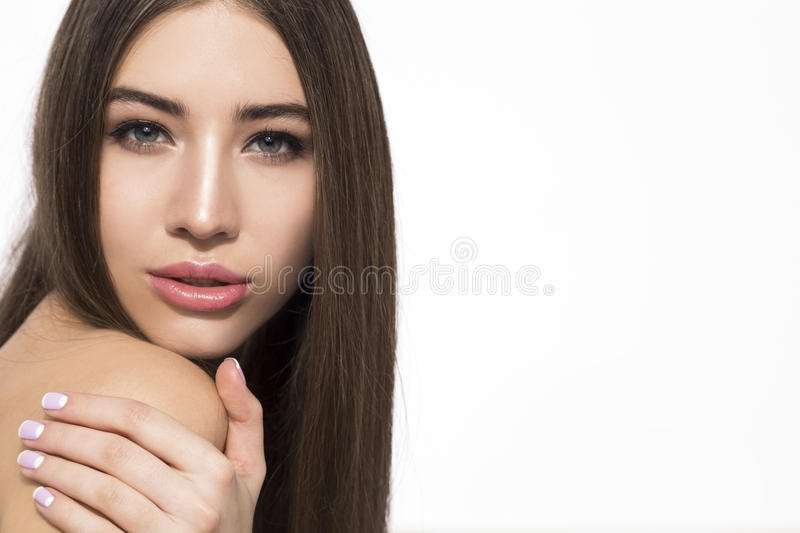 Serious woman touching her shoulder stock images