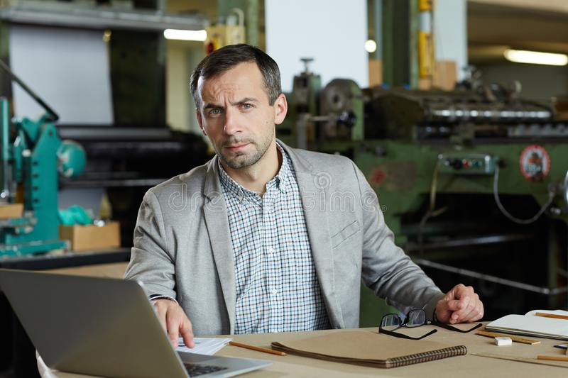 Serious worker stock image